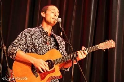 Sean Robbins wearing Reyn Spooner's Nobara long sleeve while performing.